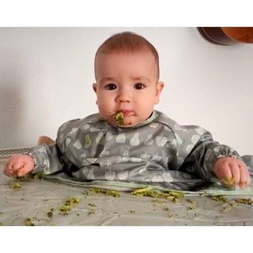 Baby loves broccoli.