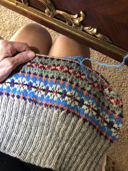 Knitting fair isle vest.