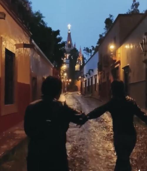 Kambria and husband singing in the rain